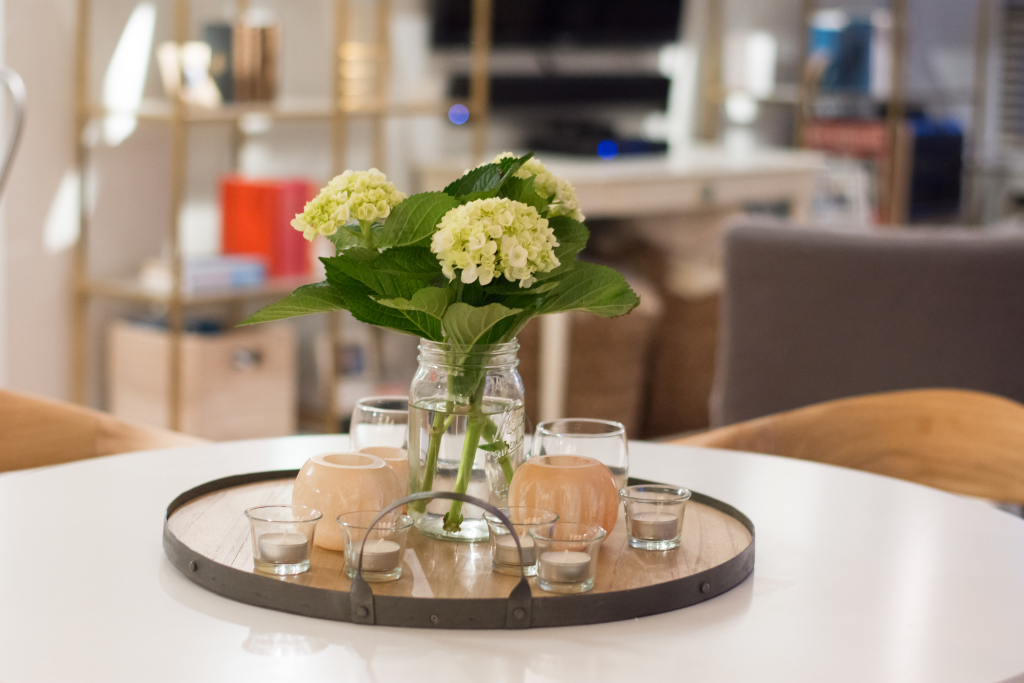 Spruce up tables, islands and entryway tables with centerpieces.